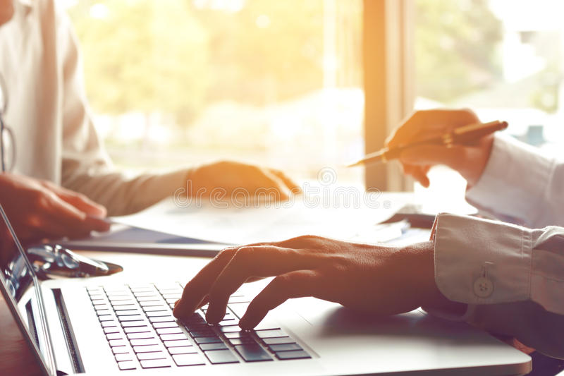Two business people teamwork working near window in office room. And taking about budget company and thinking aa problem together royalty free stock image