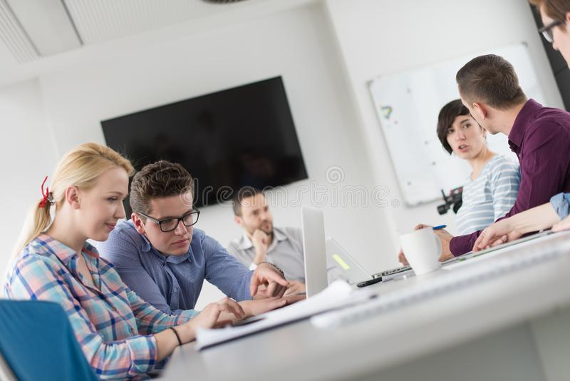 Two Business People Working With laptop in office stock photo