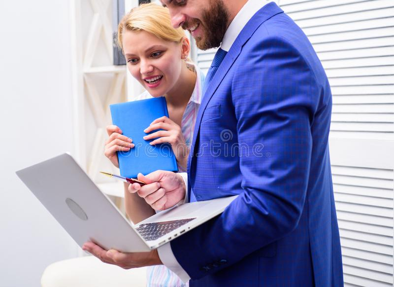 Two business people working together casual. Cheerful work of two people working in bright office. Business team royalty free stock images