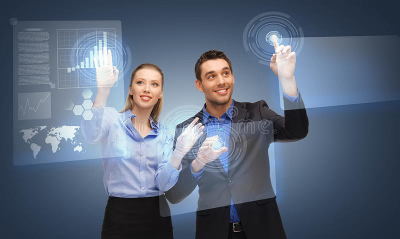 Two business people working with virtual screen stock image
