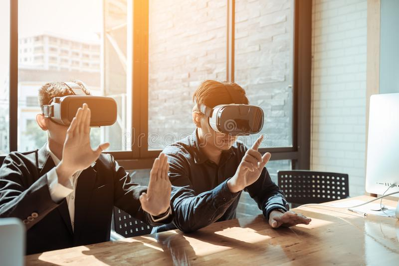 Two business business persons with virtual reality headsets in t stock photo