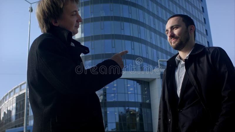 Two business professionals having a meeting outside. Professional shot on BMCC with high dynamic range. You can use it e.g in your commercial video, business royalty free stock photography