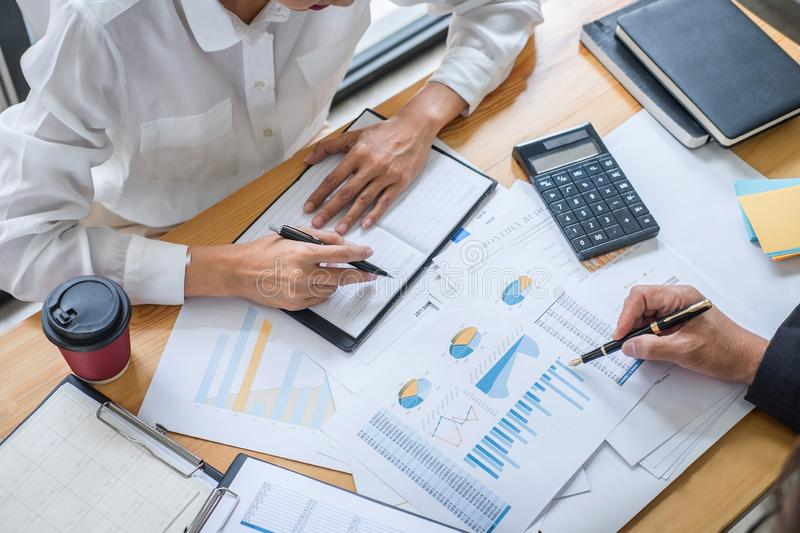 Two business team discussing and planning strategy company growth project success financial statistics, Partner meeting stock photo