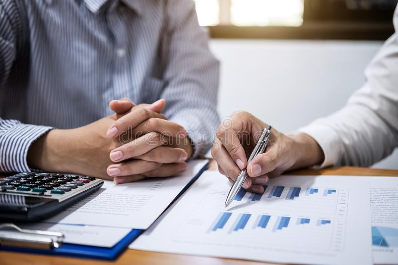 Two business team working and discussing Financial investment on. Report with calculate Analyze business and market growth on financial document data graph royalty free stock images