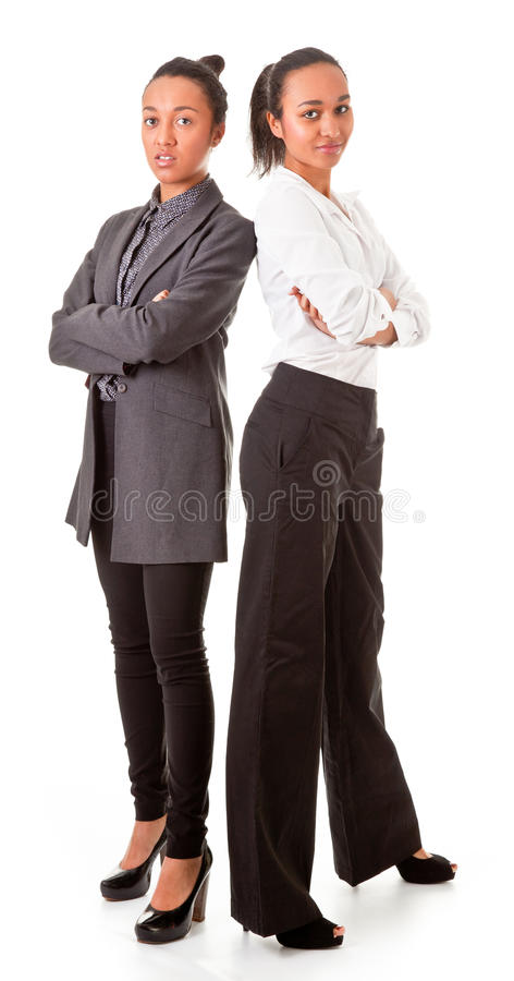 Download Two Business  Women In Casual Poses Stock Photography - Image: 23969352