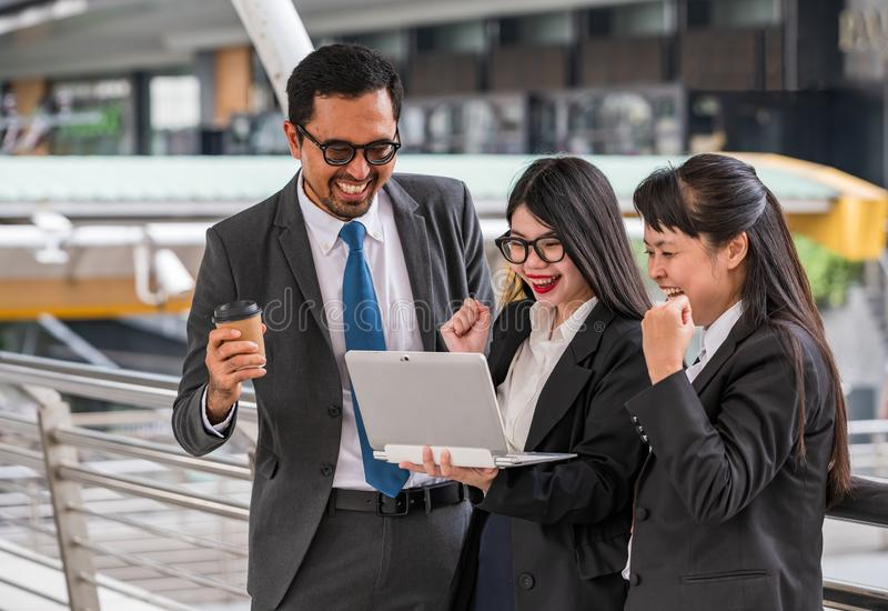 Two business women clenching their fists and a business man hold royalty free stock photos