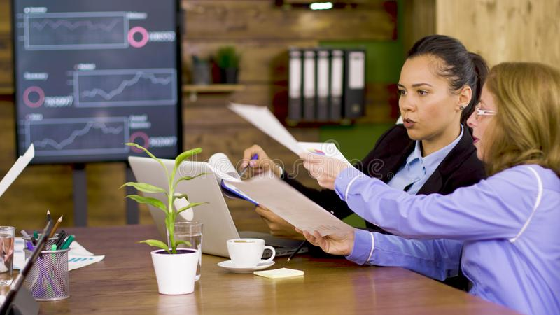Two business women in the conference room royalty free stock images