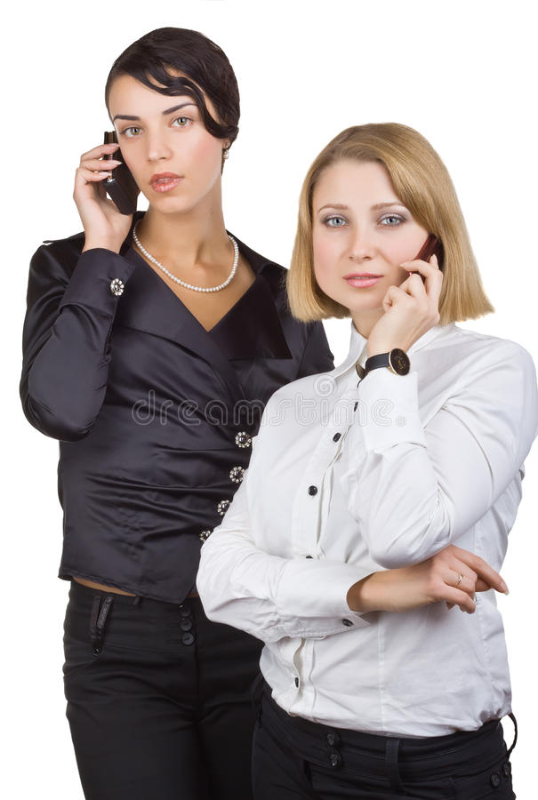 Two business women talking on mobile phone royalty free stock photo