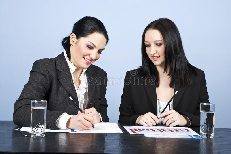 Download Two Business Women Writing In Office Stock Images - Image: 12493884