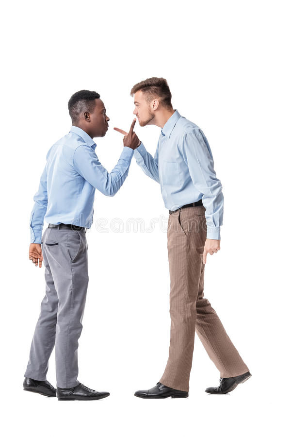 Two businessman arguing stock images