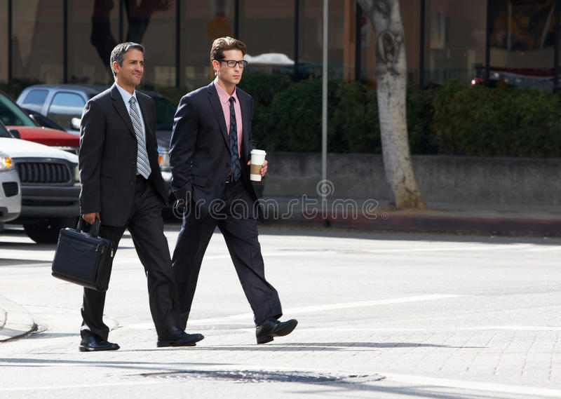 Download Two Businessman Chatting Whilst Crossing Street Stock Image - Image: 30209749