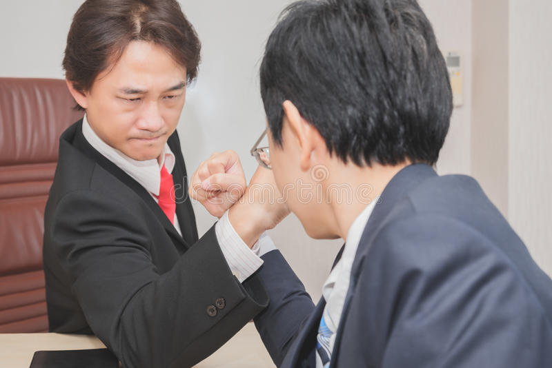 Two Businessman Competing In Arm Wrestling. Competition concept stock images