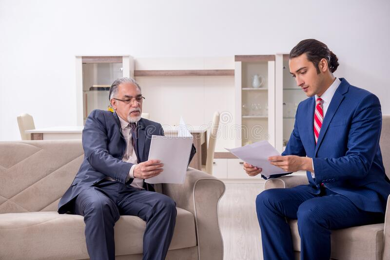 Two businessman discussing business in office stock photography