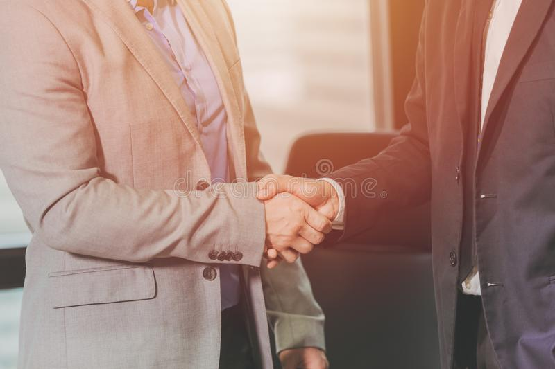 Two businessman handshake joint venture together concept royalty free stock photos