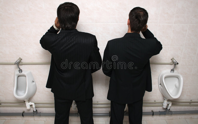 Download Two Businessman With Mobile Phones In A WC Stock Image - Image: 6335955