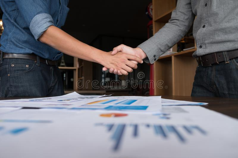 Two businessman people shaking hands with making a deal, Business people shaking hands. stock images