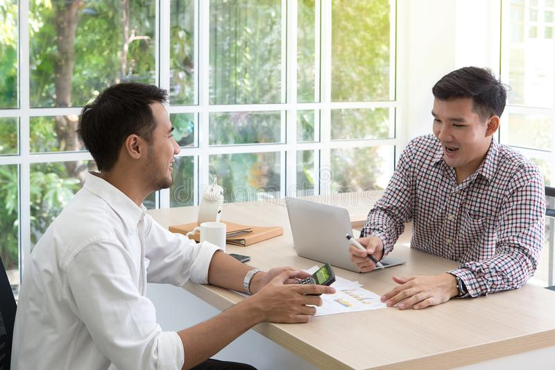 Two businessman plaining data at meeting. Business people meeting around desk. asian people. brainstorming of business. royalty free stock images