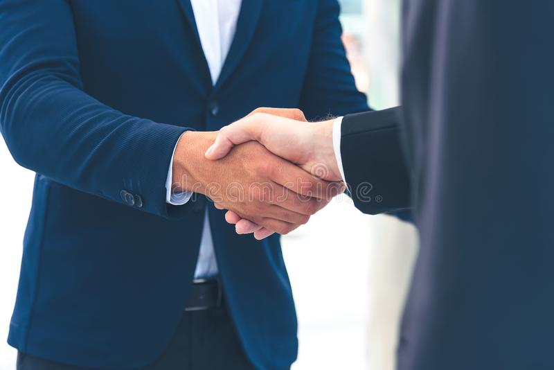 Two businessman shake hand for the first meeting. Two business people greeting outdoor stock images