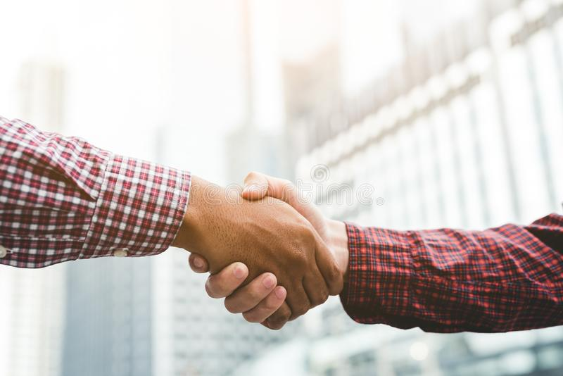 Two businessman shaking hands royalty free stock photography