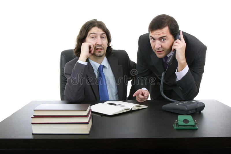 Two businessman sitting at the desk royalty free stock image