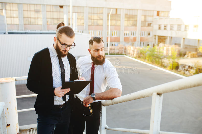 Two businessman at work stock photo