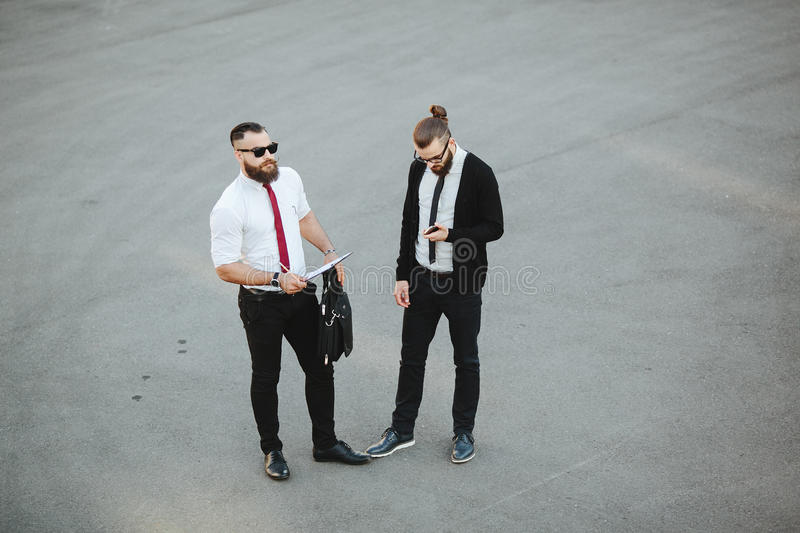 Two businessman at work stock images