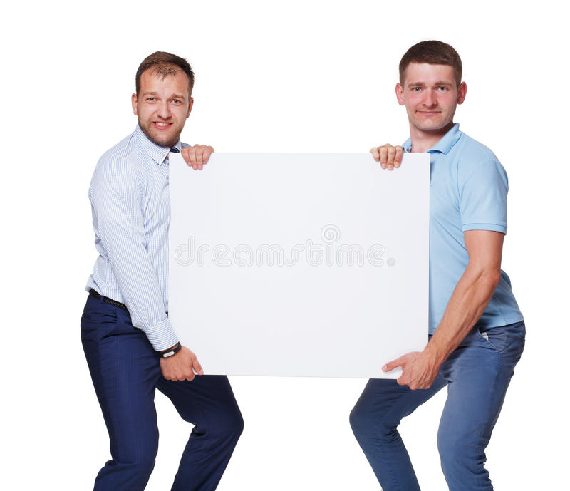 Two businessmen carry and show blank advertising board, isolated. On white background. Big white poster in man's hands with copyspace royalty free stock photography