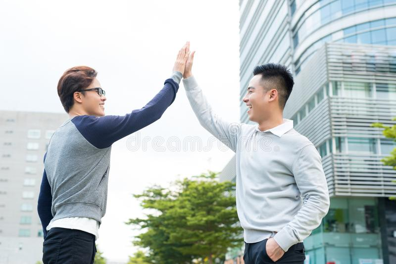 Two businessmen celebrate victory, goal reach, high five. royalty free stock photography