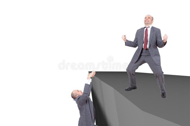 Businessmen on the edge of a cliff stock photos