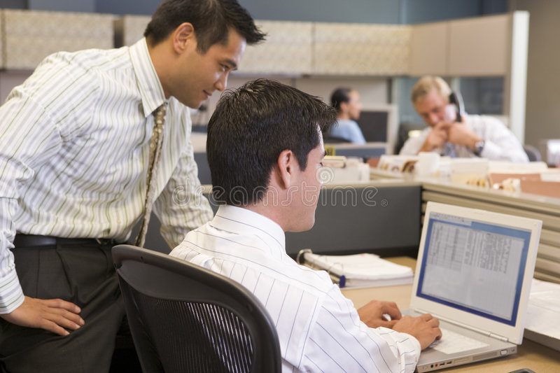 Download Two Businessmen In Cubicle Looking At Laptop Stock Image - Image: 5934055