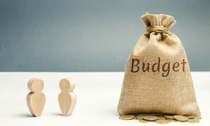 Two businessmen are discussing the company`s budget. Business planning. The distribution of costs and resources. Profit taking. Search for sources of funding stock photo