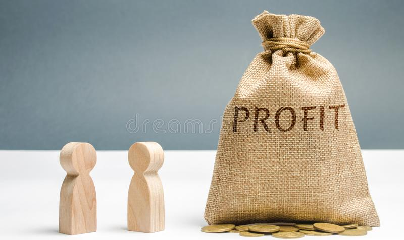 Two businessmen are discussing the company`s profit. Search for sources of funding. Business planning. The distribution of costs royalty free stock photo