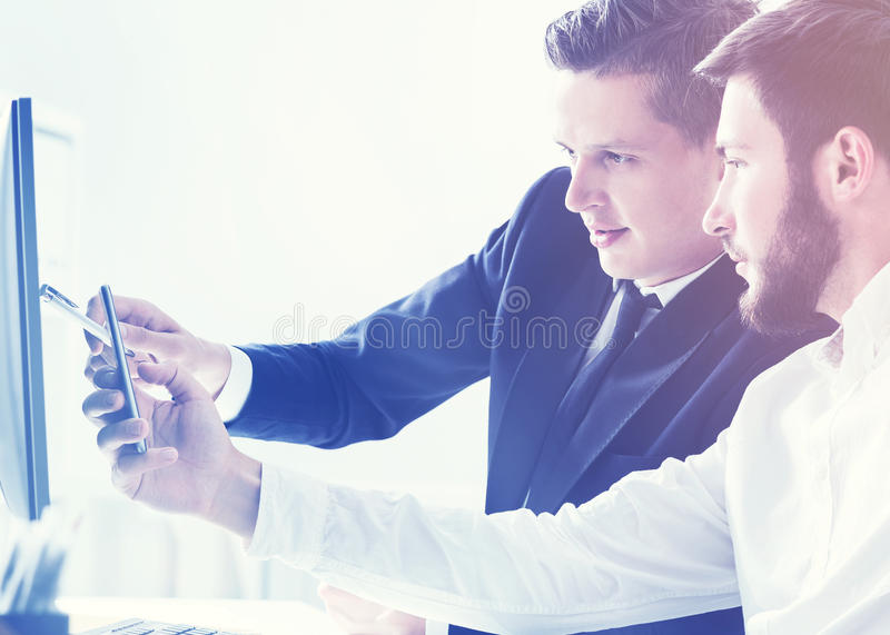 Two businessmen discussing current project royalty free stock photography
