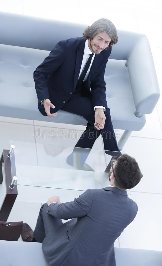 Two businessmen discussing in the workplace. Photo with copy space stock photos