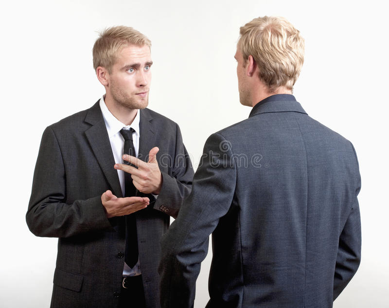 Two businessmen discussing stock photography