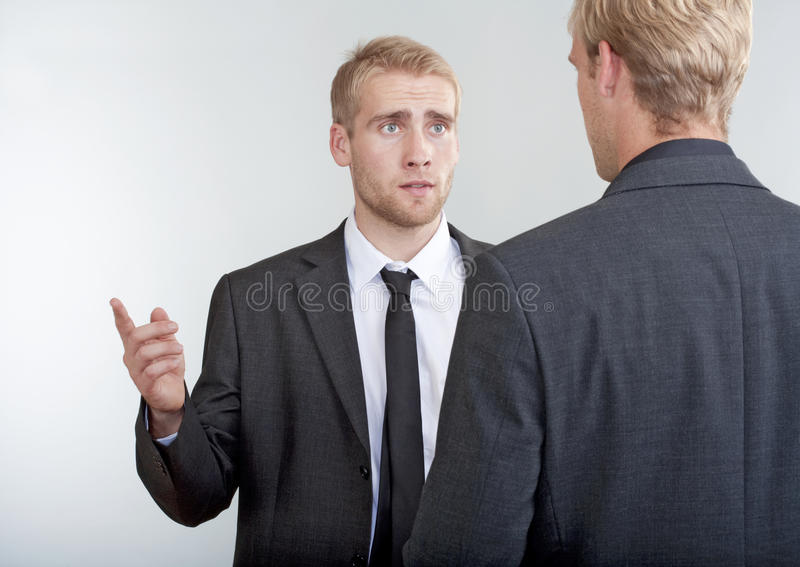 Two businessmen discussing royalty free stock image