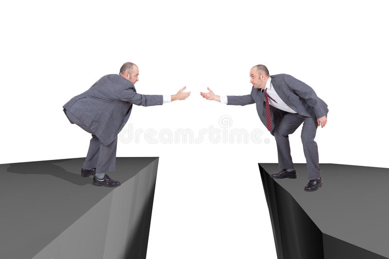 Businessmen on the edge of a cliffs reaching out royalty free stock photo