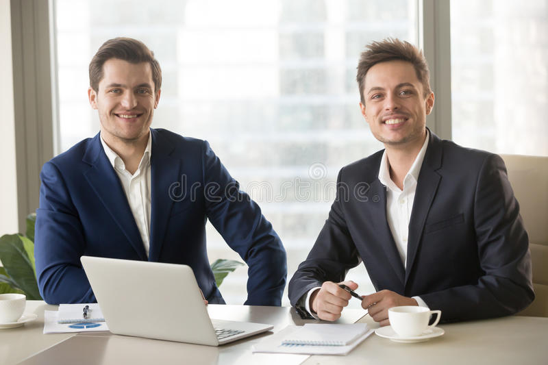 Two businessmen, financial analysts or investment advisers looki stock images