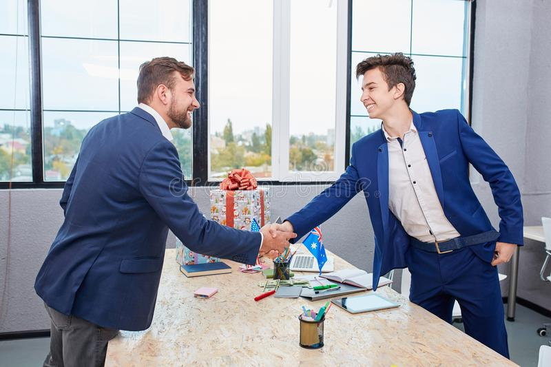 Two businessmen giving warm welcome, trust, teamwork, agreement to each other. Business concept. stock photo