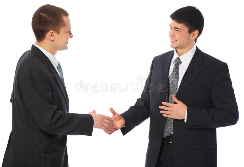 Two businessmen greet royalty free stock images