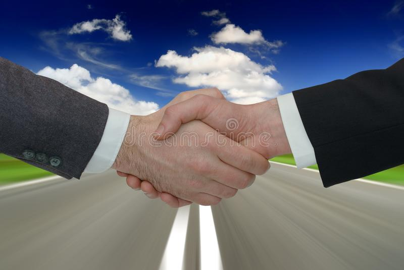 Two businessmen handshake royalty free stock images