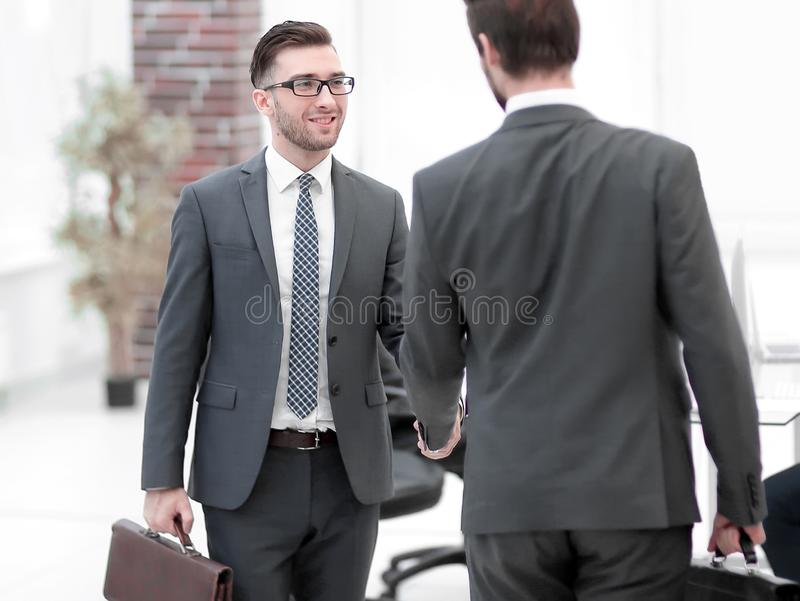 Two businessmen handshaking after striking grand deal. Job applicant having interview. Handshake while job interviewing royalty free stock image