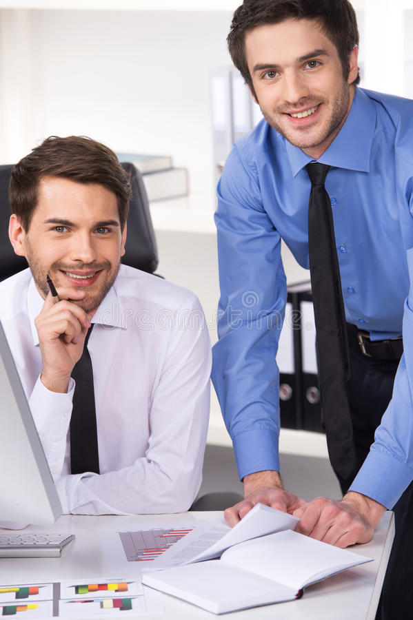 Free Two Businessmen Having Discussion In Office. Stock Images - 46238414