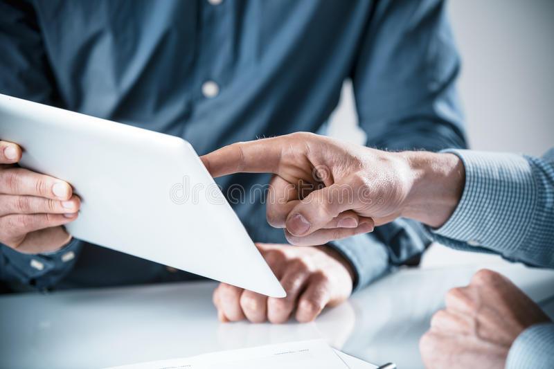 Two businessmen having a discussion royalty free stock photography