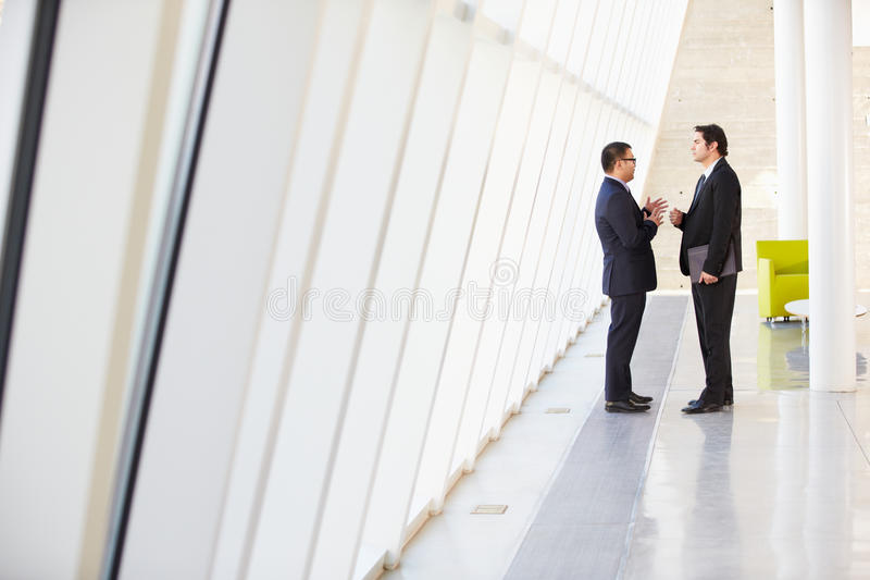Two Businessmen Having Informal Meeting In Modern Office Royalty Free Stock Photos