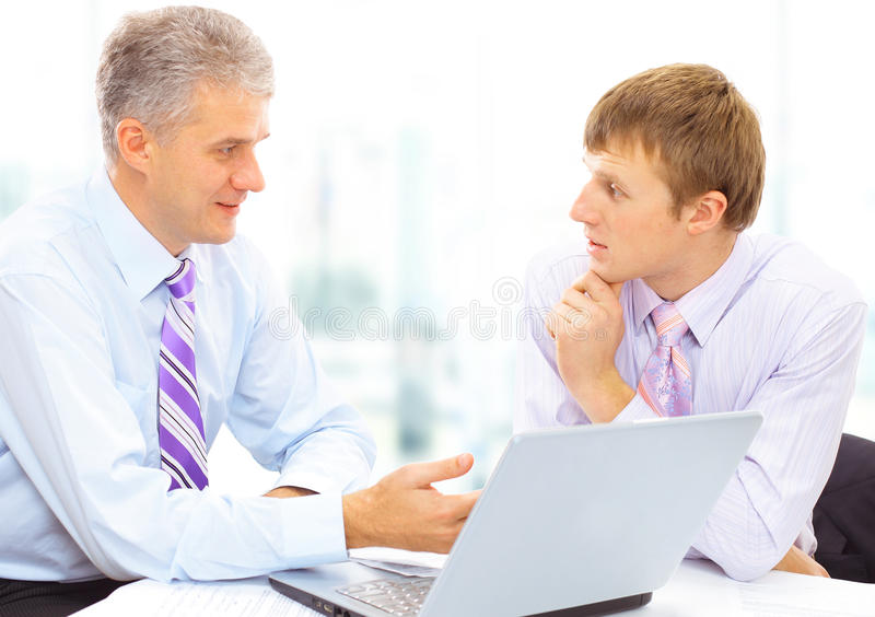 Two businessmen looking stock images