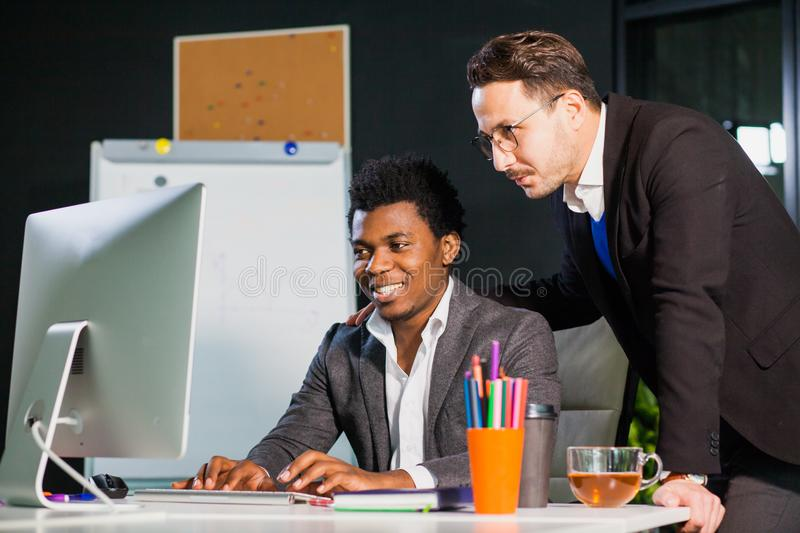 Two businessmen looking at computer screen, teamwork concept. royalty free stock photo