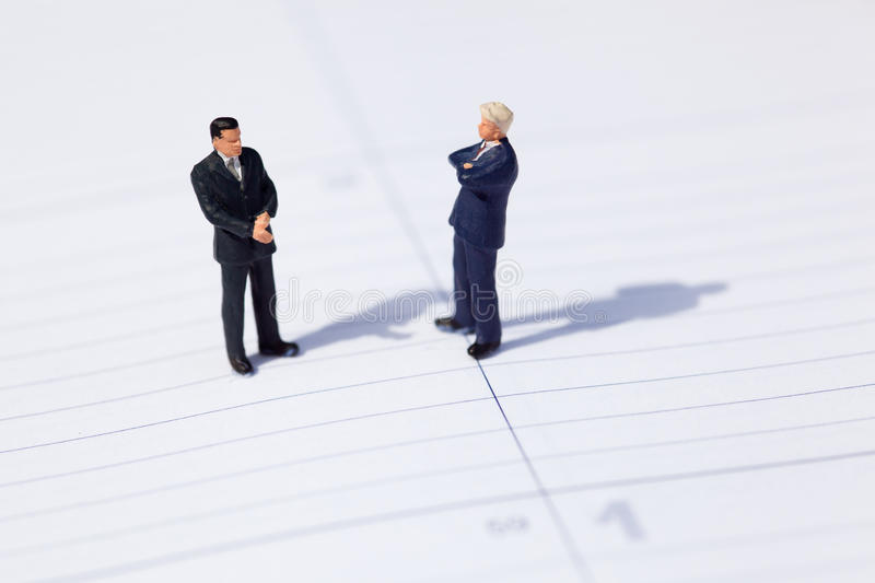 Two businessmen negotiate about a business