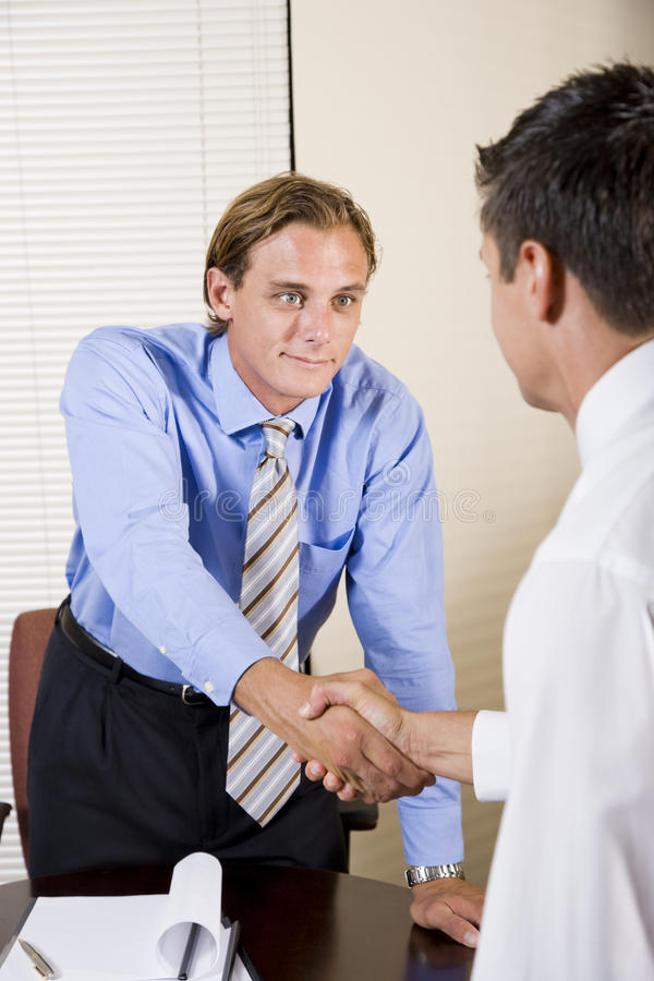 Download Two Businessmen In Office Shaking Hands Stock Image - Image: 15641593
