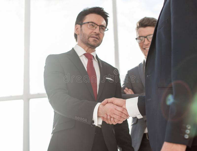 Two businessmen shaking hands. Concept of partnership stock image